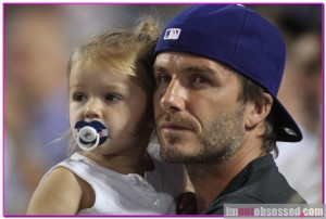 While I might not be as good looking or as wealthy as David Beckham, I can take my daughter to a Dodgers game. And you're damn right she'll be rocking a Dodgers pacifier.